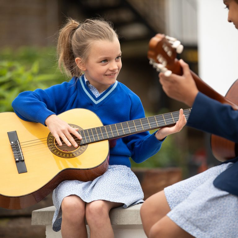 children playing guitar