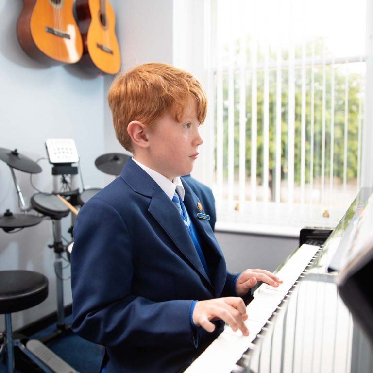 school student playing piano