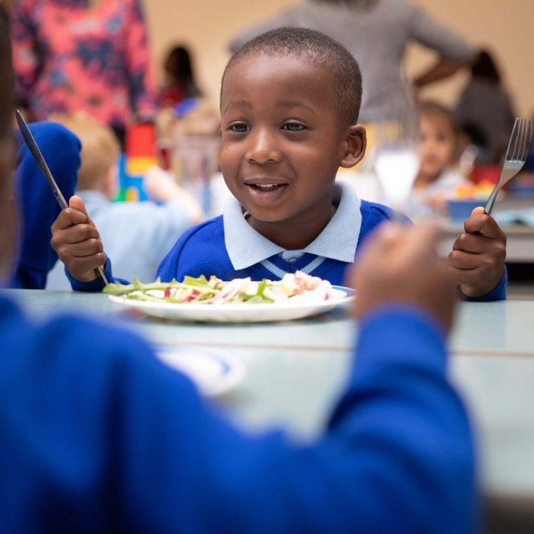 child eating a school dinner