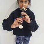 child playing recorder
