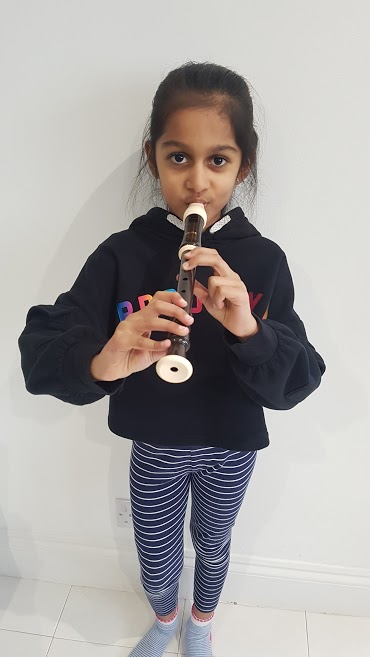 child playing recorder