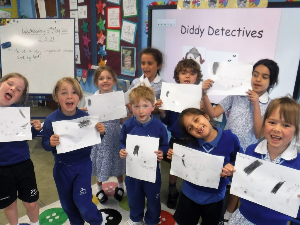 Children taking part in a detective game called Diddy Detectives