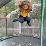 A girl jumping in a trampoline